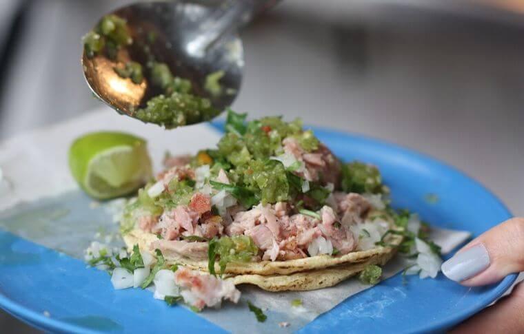 A Carnitas taco with onion & cilantro found on our Mexico City Taco Tour