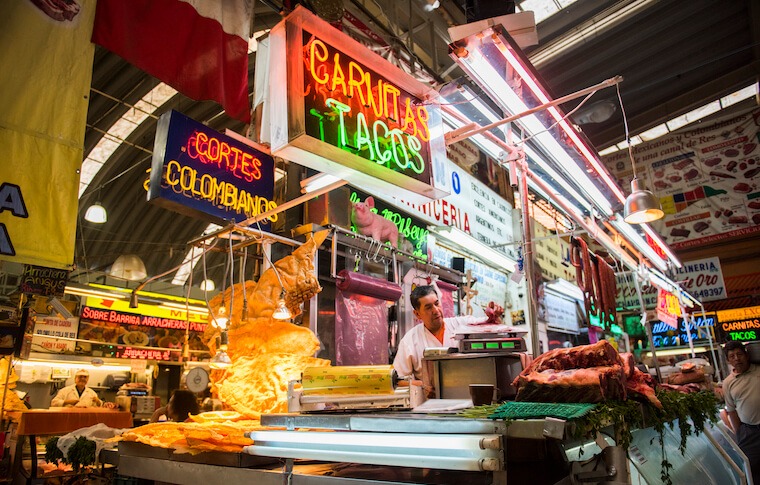 A brightly lit Mexico City Street stand on the Chilango Tacos 101 tour