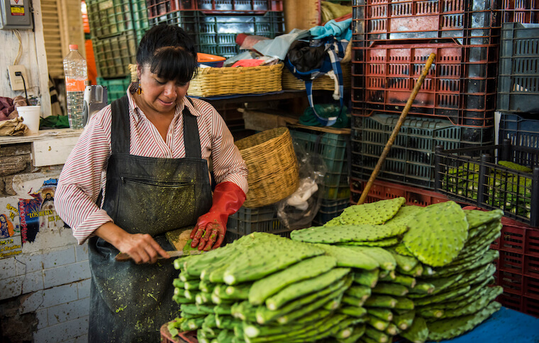 A vendor at their stand during Eat Mexico's La Merced Market tour