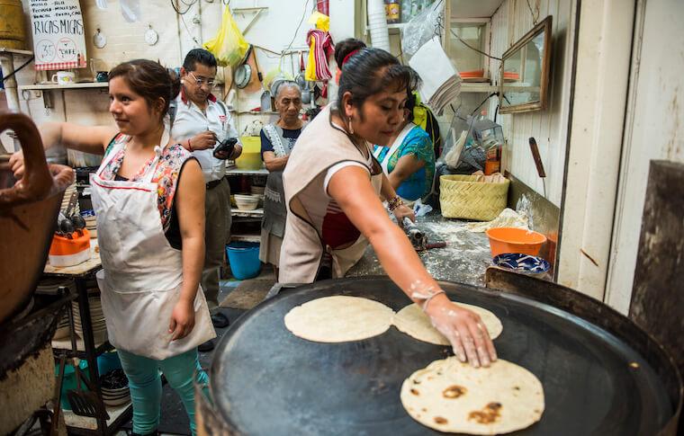 A vendor preparing tortillas at the La Merced Market in Mexico City