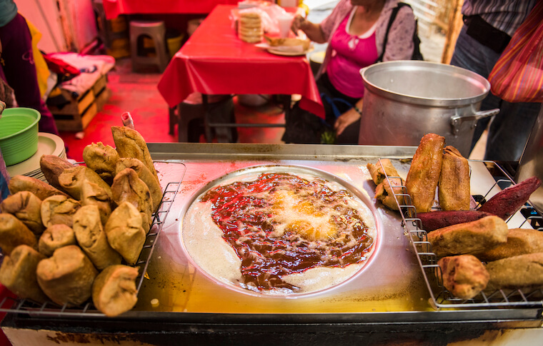 Food being fried at the La Merced market in Mexico City