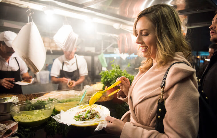 A guest trying tacos on our Mexico City Food tour