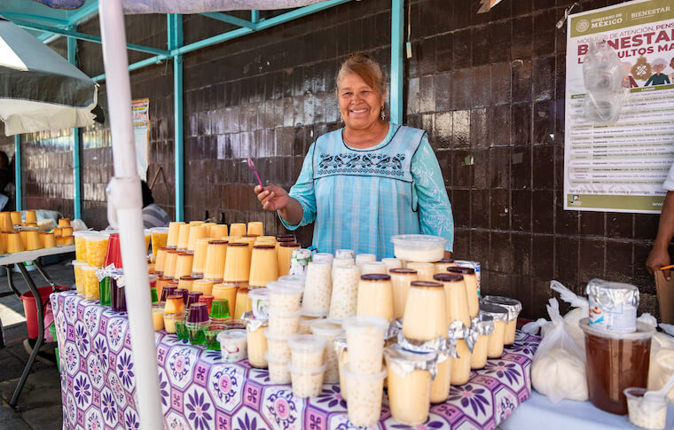 A smiling vendor selling food in Mexico City's Xochimilco neighborhood