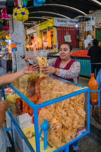 Buying Mexico City Street Food from a vendor