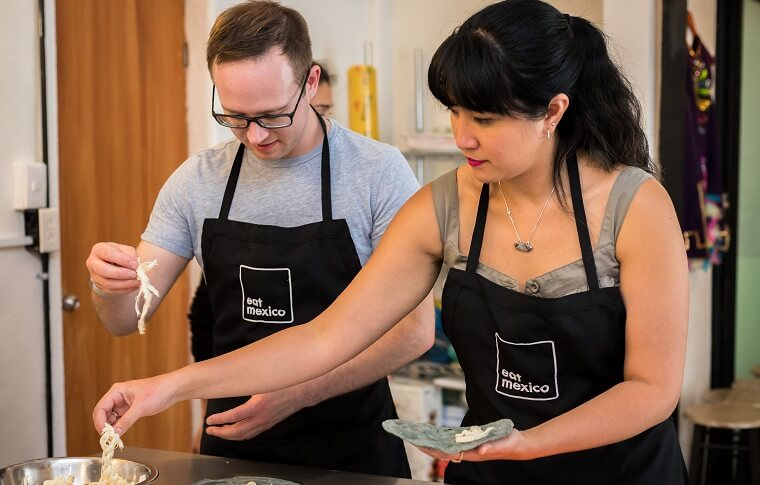 woman and man cooking in aprons