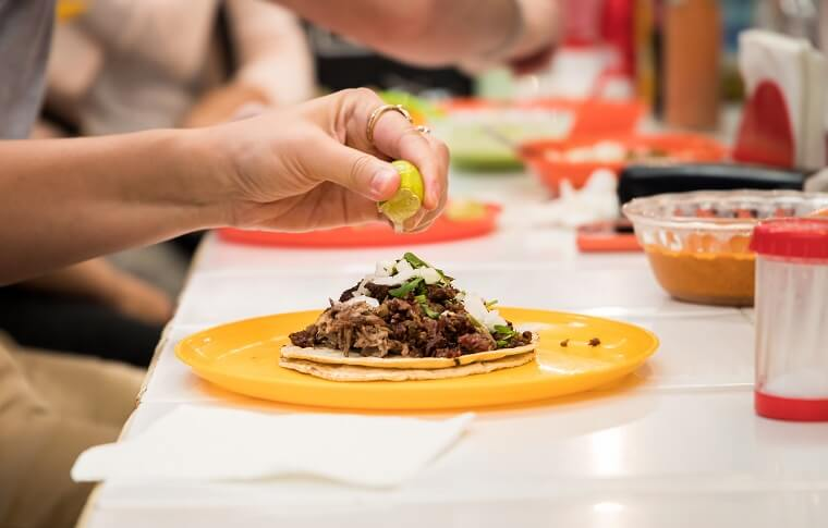 squeezing lime onto a taco